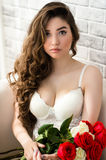 Luxurious portrait sensual woman in white lingerie with bouquet roses in hands Royalty Free Stock Photos