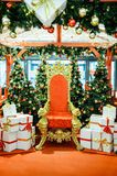 Luxurious red chair Santa Claus throne and gifts Royalty Free Stock Photo