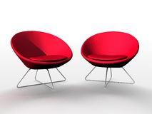 Luxurious red chairs. Closeup of two luxurious red chairs or seats isolated on white background Stock Photos