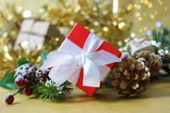 Luxurious red Christmas gift box on gold bokeh lights background. Luxurious red Christmas gift box on a gold bokeh lights background Royalty Free Stock Images