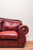 Luxurious Red Leather Couch in front of a blank wall Stock Photos