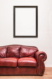 Luxurious Red Leather Couch in front of a blank wall. Luxurious Red Leather Couch in front of a blank frame to ad your text, logo, images, etc Stock Photo