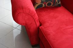 Luxurious red lounge chair. Close up of luxurious red lounge chair stock photo