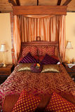 Luxurious red purple bed Stock Images