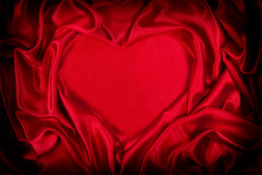 Luxurious red silk folded heart shape Royalty Free Stock Photography