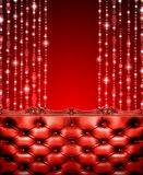 Luxurious red sofa on a red glitter background. Royalty Free Stock Photo