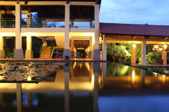 Luxurious resort hotel. Exterior of luxurious resort hotel with illuminated swimming pool in foreground, Vietnam Stock Images