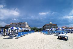 Luxurious rest on the beach in Viareggio in the low season. View from the beach in Viareggio, Tuscany, Italy, on two historic Art Nouveau hotels stock images