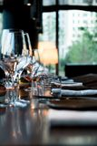 Luxurious Restaruant Gastronomy Scene Glasses on Table Decoration royalty free stock photo
