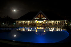 Luxurious restaurant in the night at Varadero, Cuba. Luxurious restaurant with pool illuminated in the night stock images