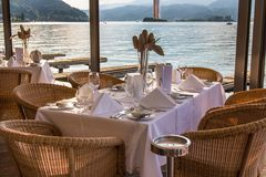 Luxurious restaurant with tables on pier Stock Photography