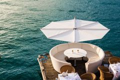 Luxurious restaurant with tables on pier Royalty Free Stock Photos