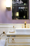 Luxurious Restroom. Beautifully Bright Restroom with Gold, White and Purple Furnishings Royalty Free Stock Photos