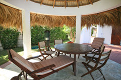 Luxurious retirement. Beautiful palm garden furniture, located in the center of the garden area, private pool, in its own retiree Germans, Americans retired Royalty Free Stock Photography