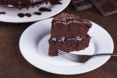 Luxurious Rich Chocolate  Cake on White Plate Royalty Free Stock Photos