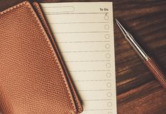 Luxurious rollerball pen. And empty to do list Stock Images