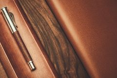 Luxurious rollerball pen. On a wooden background Stock Photography