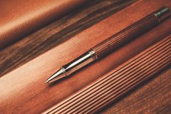 Luxurious rollerball pen. On a wooden background Stock Photos