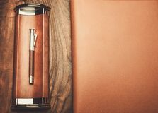 Luxurious rollerball pen. On a wooden background Royalty Free Stock Photography