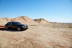 Luxurious Rolls Royce car emitting pollution Stock Image
