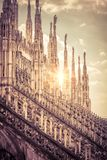 Luxurious roof of Milan Cathedral in sun light. Luxurious roof of Milan Cathedral Duomo di Milano in Milan, Italy. Gothic pinnacles with statues at the top of royalty free stock photography