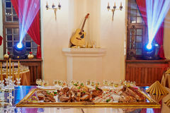 Luxurious royal banquet. Sumptuous food and wine glasses at luxurious royal banquet Royalty Free Stock Images