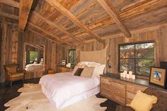 Luxurious Rustic Log Cabin Bedroom Stock Photography