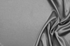 Luxurious satin. Luxurious grey satin background closse up Royalty Free Stock Photography