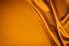 Luxurious satin. Luxurious gold satin background closse up Royalty Free Stock Photo