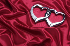 Luxurious satin with hearts Stock Photo