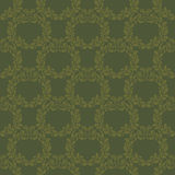 Luxurious seamless pattern in dark green tones. Wreaths made of. Oak leaves and acorns Royalty Free Stock Photo