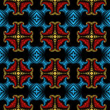 Luxurious seamless pattern with golden, metallic red and blue decorative ornament on black background Royalty Free Stock Images
