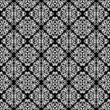 Luxurious seamless pattern. White ornate Damask ornament on a black background. Elegant tracery from swirls and foliage. Ideal for textile print and wallpapers Stock Photography