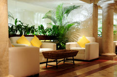 Luxurious seating in lobby. Details of luxurious seating and decorative plants in lobby area Stock Photo