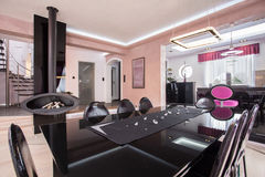 Luxurious shiny dining room. In modern posh house royalty free stock image
