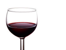 A luxurious single glass of rich, dark red wine is Royalty Free Stock Photos
