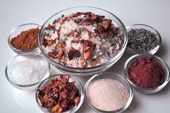 Luxurious spa bath salts with ingredients, closeup. Luxurious spa bath salts with ingredients in small glass bowls, closeup stock image