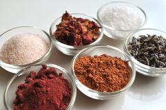 Luxurious spa bath salts ingredients, closeup. Luxurious spa bath salts ingredients in small glass bowls, closeup royalty free stock images