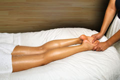 LUXURIOUS SPA FOOT MASSAGE. Foot massage being offered by a luxury day spa. Massage being given by an African American woman Royalty Free Stock Image