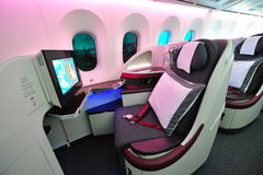 Luxurious and spacious business class seats in a Qatar Airways Boeing 787-8 Dreamliner at Singapore Airshow. SINGAPORE - FEBRUARY 12: Luxurious and spacious Stock Image
