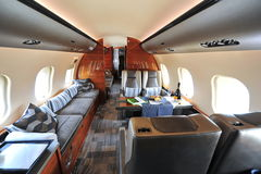 Luxurious and spacious interior of Bombardier Global 6000 business jet at Singapore Airshow. SINGAPORE - FEBRUARY 12: Luxurious and spacious interior of royalty free stock image