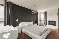 Luxurious and spacious master bedroom. In modern residence stock image