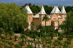 Luxurious Spanish mansion. Scenic view of luxurious Spanish mansion in landscaped gardens with forest in background, Catalonia, Spain Stock Images