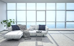 Luxurious, bright penthouse living room and sofa royalty free stock photo