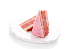 Luxurious sweet dessert. Luxurious pink layered punch cake on white vintage plate on white background. Culinary sweet dessert eating Stock Image