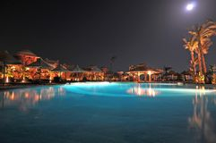 Luxurious swimming pool. Low angle view of luxurious swimming pool illuminated at night Stock Photography