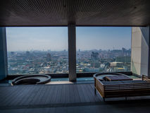 Luxurious swimming pool with city view Stock Images