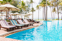 Luxurious swimming pool with the ocean views Royalty Free Stock Photo
