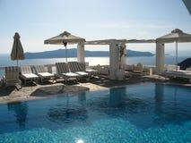 Luxurious swimmingpool. Nice and luxurious swimmingpool on santorini royalty free stock image