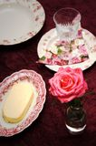 Luxurious Table Setting. Luxuriuos table setting with pink rose on purple velvet Stock Photo